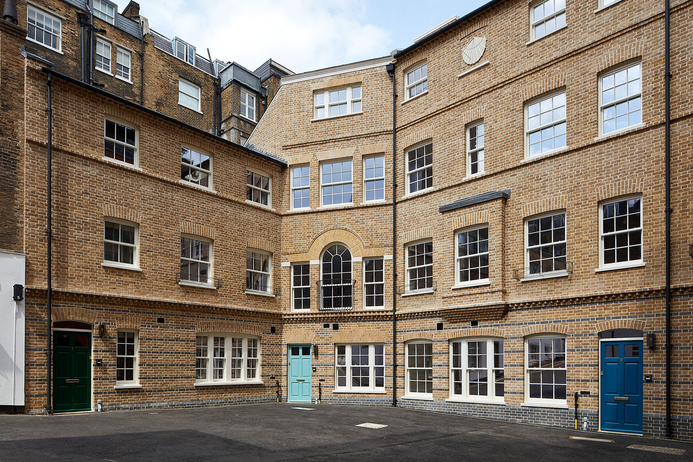 Replacement houses at Dean's Mews, London